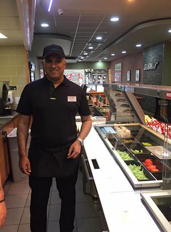 Mo at his Subway kitchen counter