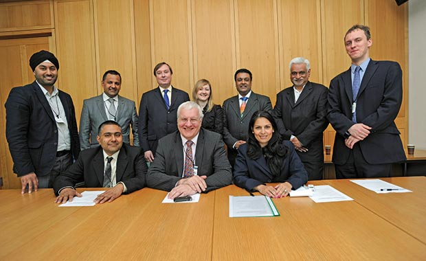 Pictured (clockwise from top left) Rav garcha, Paul Cheema, NFRN public affairs executive Adrian Roper, RN features editor Chris Rolfe, Paul Patel, Mukesh Patel, Rn deputy features editor Tom GK, Priti Patel MP, Peter Wagg and Pinda Cheema at the RN Summit