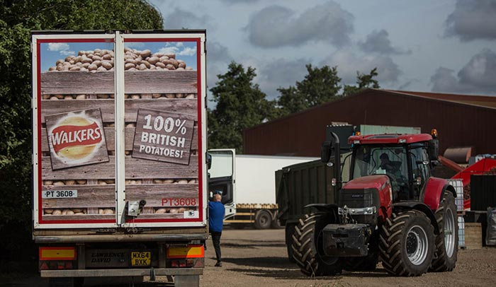 walkers-lorry-with-tractor-on-potato-farm